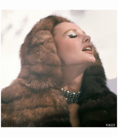 Brigitte Bauer in a hooded coat of natural Russian Crown sable. Necklace by Trifari,   Vogue, 1963 Henry Clarke