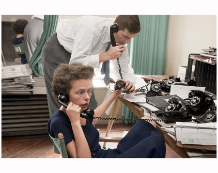 Eileen Ford and her husband, Jerry, jugglephones and field requests for Ford models in theagency's New York office,1948. Digital Colorization by Lorna Clark By Nina Leen