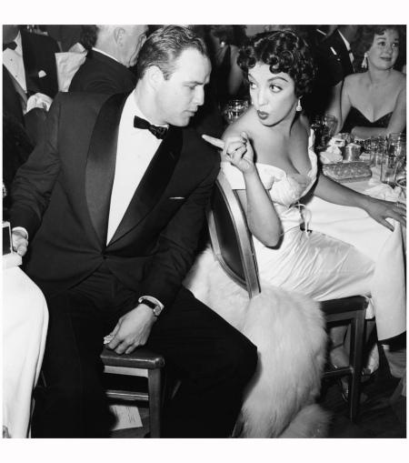 Marlon Brando & Katy Jurado At Awards Dinner Marlon Brando (1924 - 2004) turns to face Mexican actor Katy Jurado (1924 - 2002), who gestures at him during a formal awards dinner, 1950s