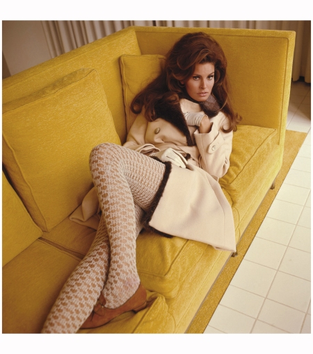 Raquel Welch on a Yellow Sofa 1967--Norman-Parkinson-Ltd
