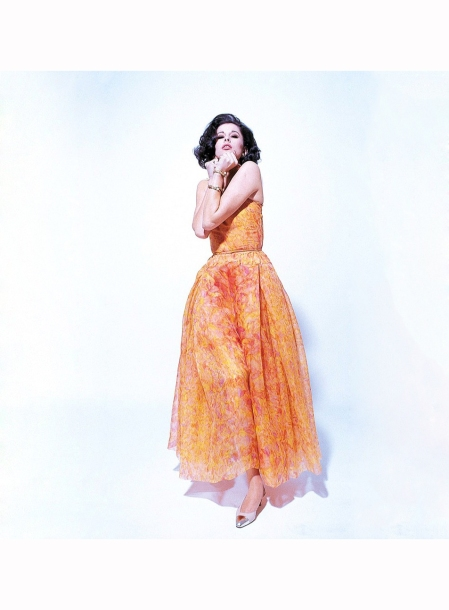 Tamara Nyman in flowing chiffon dress in shades of orange by Chanel,1962 Willy Rizzo