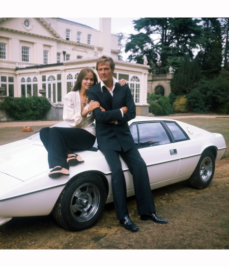 Barbara Bach and Roger Moore, stars of the James Bond film 'The Spy Who Loved Me' leaning on the now-famous 'amphibious' Lotus Esprit 1977