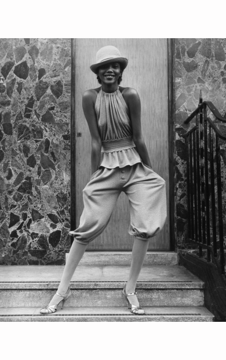 Fashion model Hazel wearing coffee-coloured knickerbockers and a peplum bib top designed by John Bates for Jean Varon Frank Barratt