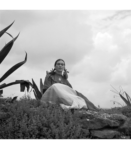 Frida Kahlo seated next to an agave plant in 1937 Vogue by Toni Frissell