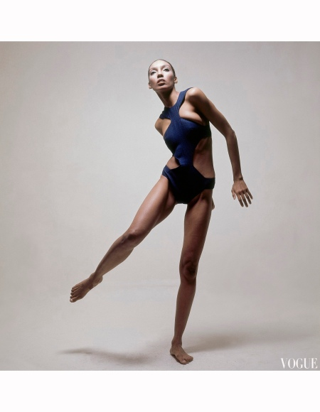 Model Kellie Wilson wearing a navy halter top, one piece bathing suit with the sides cut out by Gres Vogue 1969 Bert Stern copia
