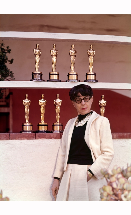 Posing with her eight Academy Award statuettes, Edith Head still holds a record in the Costume Design category
