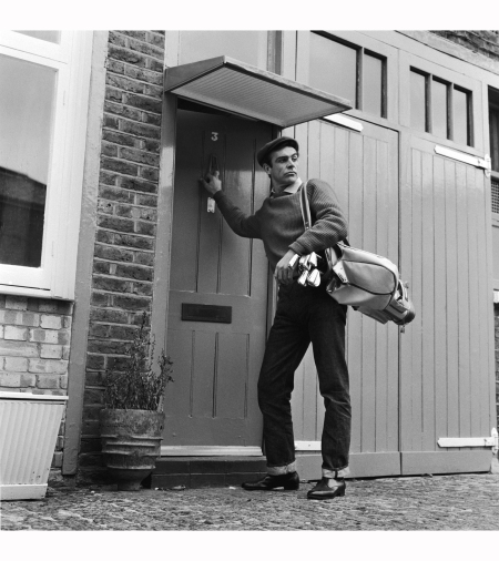 Sean Connery the new face of superspy James Bond, leaves his basement flat in London's NW8 for a game of golf, his favourite pastime 1962 Chris Ware