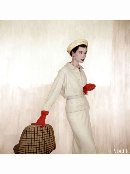 Barbara Mullen wearing beige suit and blouse of wool-and-rabbit's- hair by Larry Aldrich Vogue 1953 © Clifford Coffin