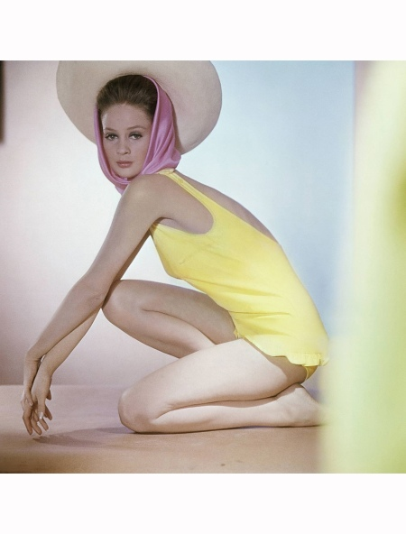 Celia Hammond wearing yellow maillot with ruffle, by Catalina, and straw hat over bright pink scarf Vogue may 1963 © Horst P. Horst