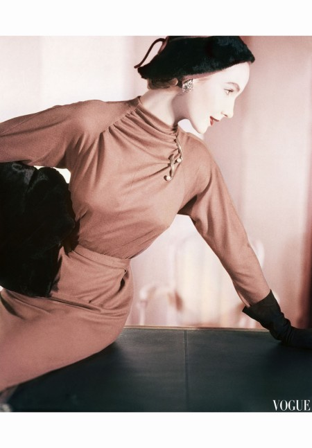 Cherry Nelms Wearing a Wool Copper Fitted Diner Dress and a Furry Black-Brown Hat with Leather Gloves sept 1953 copia