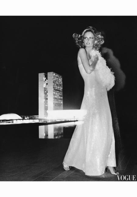 Cheryl Tiegs standing-before the towers of congress Brazil In Halston dress December 1973 - US Vogue © Kourken Pakchanian
