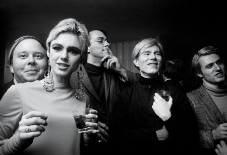 "Edie Sedgwick and Andy Warhol with (from left) Henry Geldzahler, Foo Foo Smith, and Gerard Malanga, photographed by Steve Schapiro in New York City, 1965 ""IT"" PARADE © Steve Schapir"