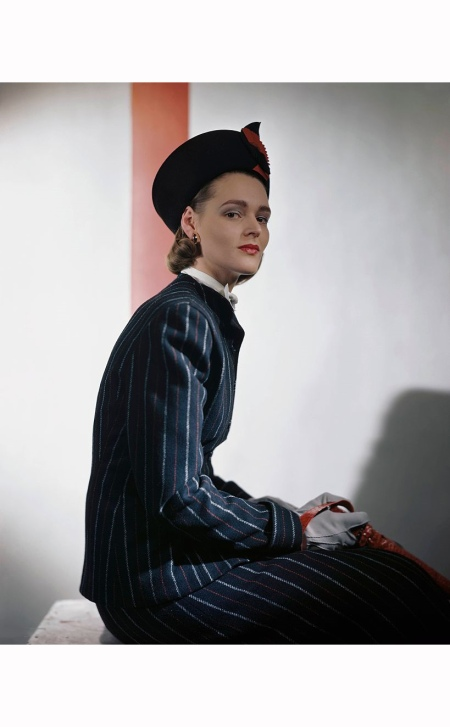 Elizabeth Olmsted, of the Glamour Fashion Department, in striped Kingsdale suit with guardman's hat and bow-tie Glamour 1946