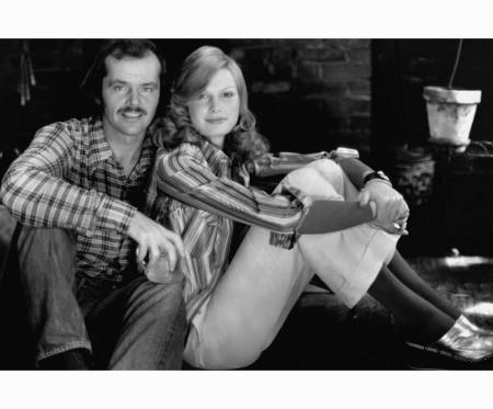 Jack Nicholson with model Denise Hopkins wearing striped shirt by T. Courtney Scott Ltd., Danskin leotard, Ralph Lauren pants of cotton corduroy, Anne Klein for Accessocraft bracelet, Robert Zentall bracelet Glamour Jan 1973 Rico Puhlman