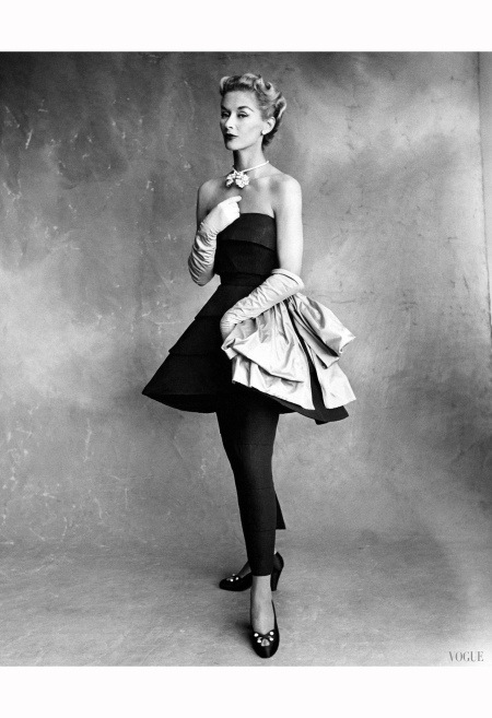 Lisa Fonssagrives in black pebbled taffeta tunic dress over slit sheath skirt, breaking the blackness, an absinthe paper taffeta bow, by Molyneux, photo by Irving Penn, Vogue September 1, 1950