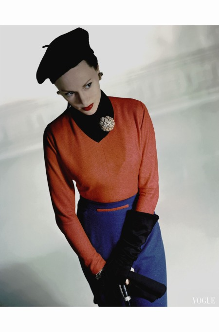 Meg Mundy wearing red shirt by Valentina, skirt, beret, gloves and neck pin Vogue - March 1947