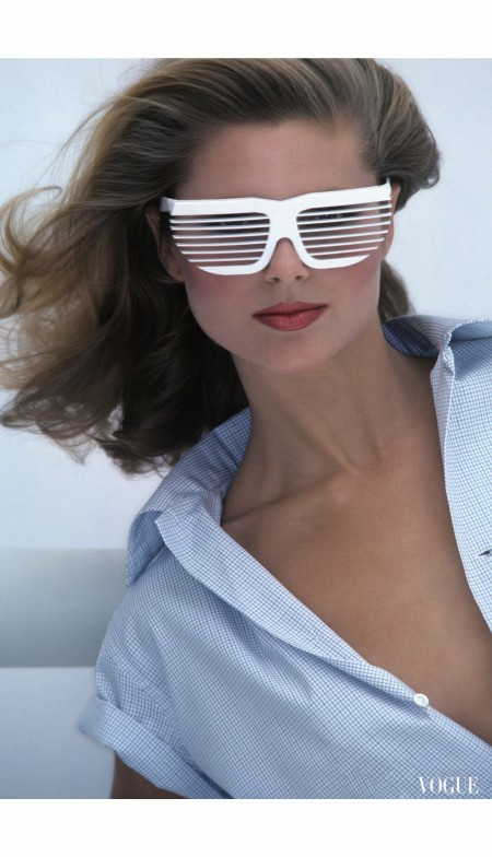 Model Christie Brinkley wearing Venetian-blind sunglasses by R&D Volpini. Vogue March 1973 Jacques Malignon.