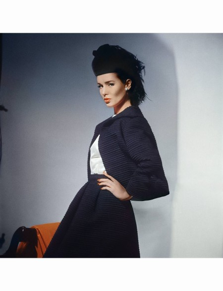Model in black wool ottoman Scaasi jacket and belled skirt with white blouse © Horst P. Horst