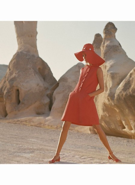 Model in Goreme, Turkey, wearing sleeveless red button-front linen dress by Kasper for Joan Leslie Dec 1966