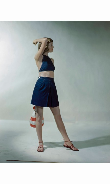 Model in navy blue Ameritex rayon garbadine shorts and halter with Bandstand red stitching © Constantin Joffe