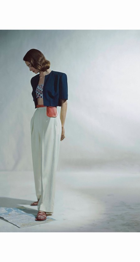 Model in red, white and blue rayon garbadine slack suit with bolero by Arrowhead © Constantin Joffe