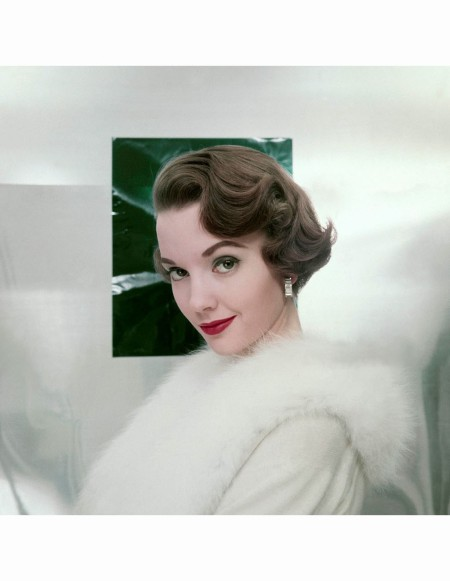 Model, in white fur-trimmed coat, with makeup by Max Factor and hair by Jean de Chant © Leombruno-Bodi