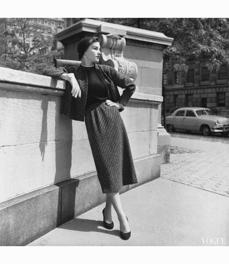 Model leans on stone wall Vogue October 1952 © Horst P.Horst