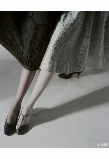 Model showing legs wearing black stockings and wearing white stockings by Artcraft with brown satin sandals horst-p-horst-vogue-october-1953