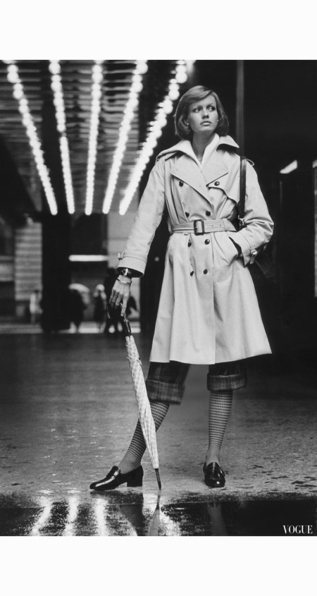 model-wearing-a-weatherbee-poplin-trenchcoat-over-rolled-up-plaid-pants-and-checked-socks-holding-umbrella-nyc-1973-condc3a9-nast-archive-photo-kourken-pakchanian