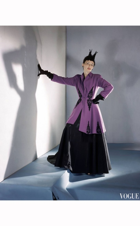 Model wearing black and purple tunic-coat, with jet embroidered motifs, twinkling also in head-dress Vogue 1941 © Horst P. Horst