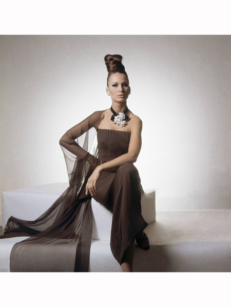 model wearing brown silk chiffon full length dress, strapless with sheer shawl, by Adele Simpson Vogue 1964