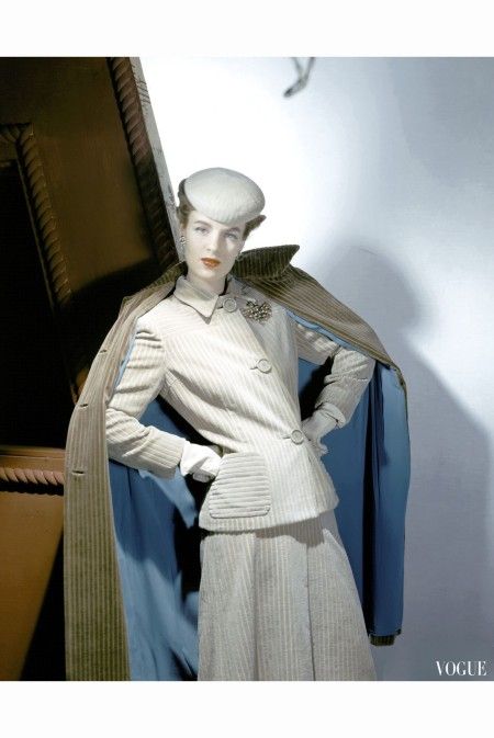 Model wearing corduroy suit, turquoise-lined coat, and gloves Vogue August 1942 © Horst P.Horst