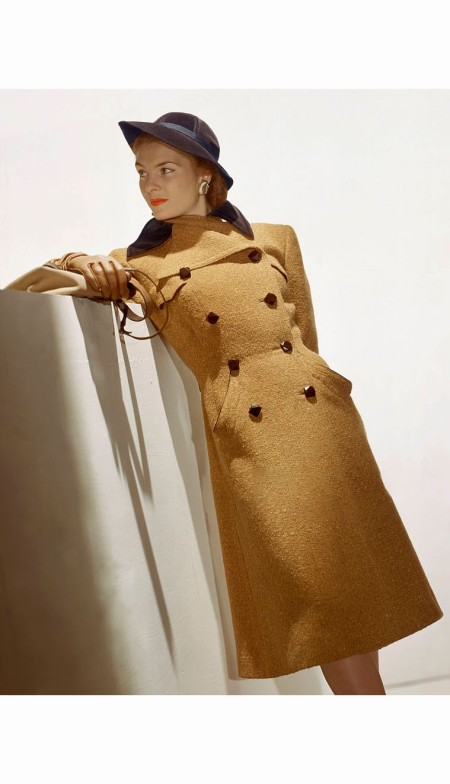 Model wearing double-breasted mustard-color tweed coat from Henri Bendel Aug 1943 © John Rawlings