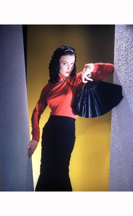 Model wearing jet-and-wool snood, red lipstick, and matching red-and-black, wool-embroidered jersey skirt, and lisle sweater with self-wrinkled sleeves Vogue Nov 1940 © Horst P. Horst