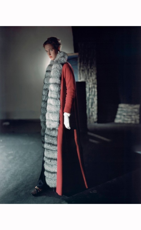 model wearing Mainbocher's evening coat, floor-length crimson cloth and silver fox Vogue 1947