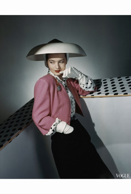 Model Wearing White Hat by Arnold Constable and Pink and Black Skirt Suit by Carolyn Modes  April 1942