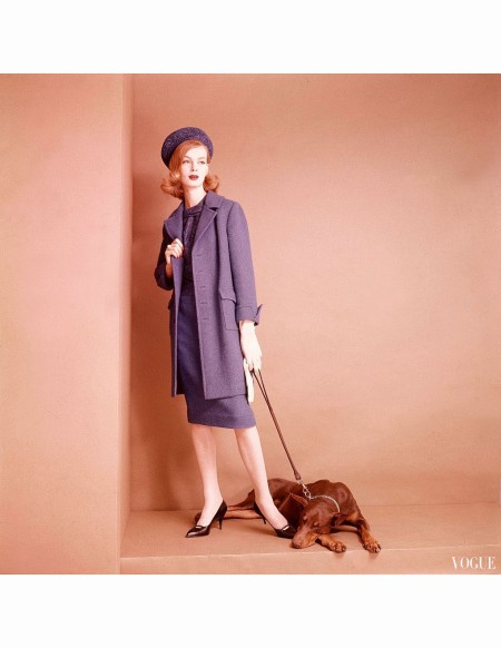 Nena posed with her sleeping, leashed, dog, and wearing a Royal blue skirt suit by David Crystal, and matching hat by Lilly Dache Vogue 1959 © Leombruno-Bodi