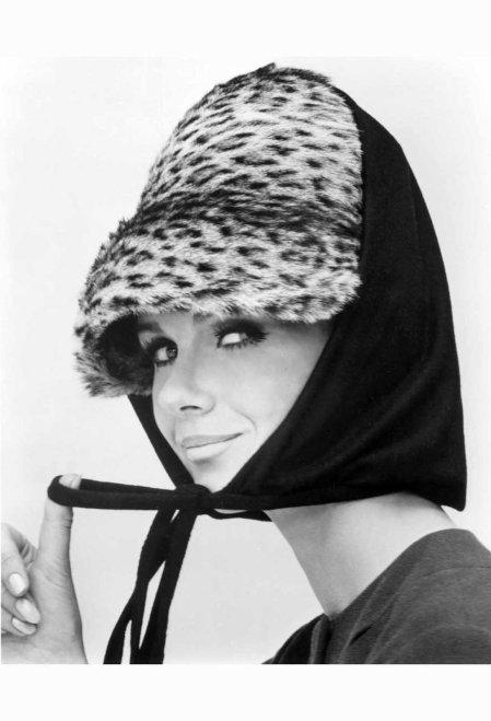 Nicole de la Marge in an Otto Lucas Jersey Scarf over an Ocelot Hat, 1964