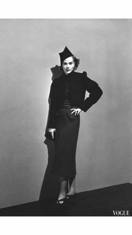 Princess Nathalie Paley wearing a Persian lamb bolero, a three-quarter-length wool dress by Lucien Lelong, and a striped hat by Reboux Vogue - December 1936 André Durst
