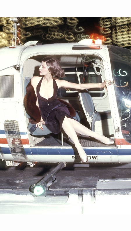 Samantha Jones at the door of a helicopter in a short bare dress by Chester Weinberg US Vogue July 1972 © Kourken Pakchanian