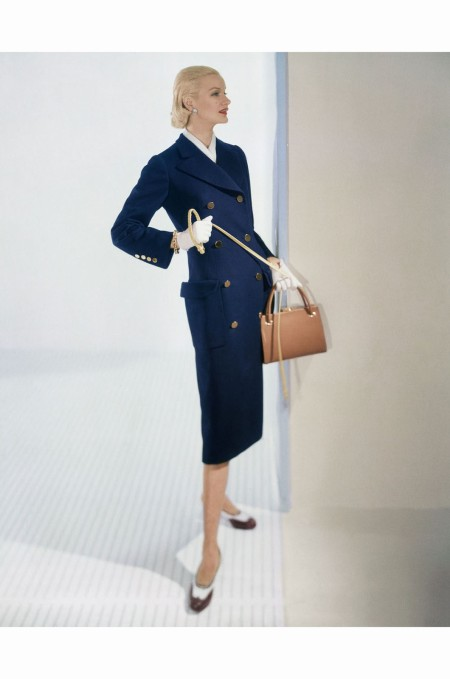 Sunny Harnett Wearing Long-Bodied, Slim Lined Navy Blue Wool Coat with Brass Buttons feb 1955