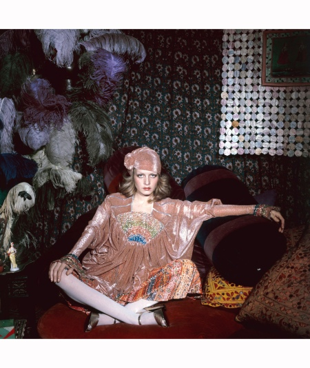 Twiggy sits cross-legged in an exotic tent constructed in Justin de Villeneuve's home 1972 Justin de Villeneuve