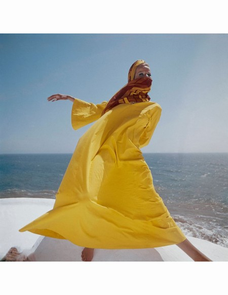 Veruschka, wears a yellow caftan and a red and yellow head scarf Nov 1965