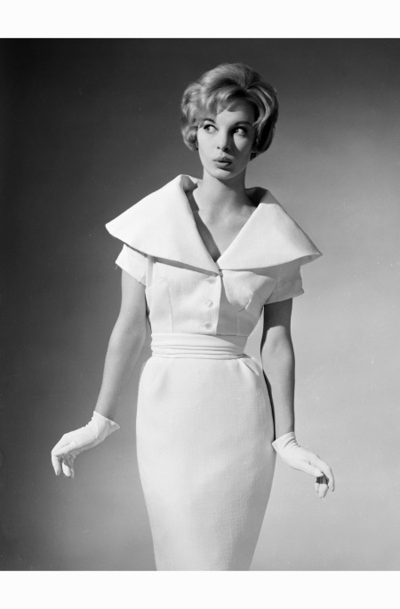 A woman feigns innocence to intensify the purity of her immaculate white dress and gloves 1960 chaloner-woods-town-dress