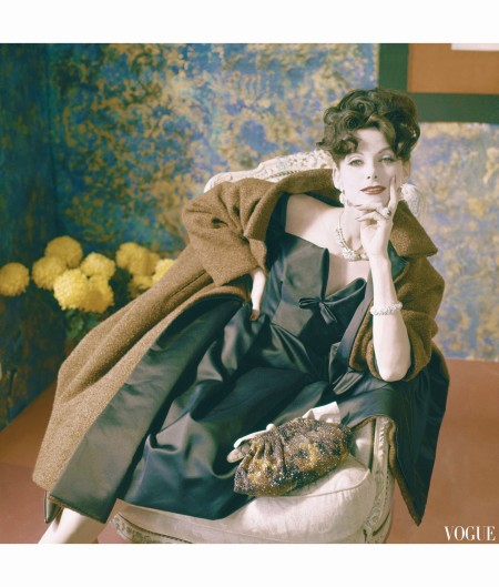 Anne Saint-Marie wearing cinnamon brown wool tweed evening coat, lined in black satin over matching black satin dress horst-p-horst-vogue-october-1959