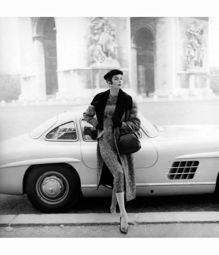 anne-st-marie-in-front-of-mercedes-wearing-tweed-dress-matching-coat-with-fur-collar-fur-hat-and-gloves-all-by-patou-holding-handbag-with-larc-de-triomphe-in-background-vogue-s
