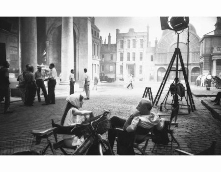 Audrey Hepburn and George Cukor chat after filming  has finished for the day set on Covent Garden %22 My FaIr Lady%22  1963 © Bob Willoghby