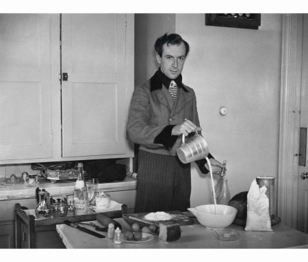 Cooking in one of his Lanz of Salzburg jackets in Ashcombe House, Wiltshire, July 1936. Photograph by Sasha