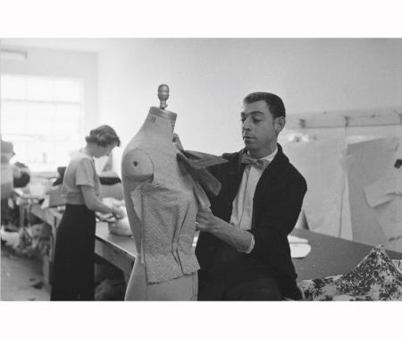 Fashion designer James Galanos pinning fabric onto dress form dummy; prob. California 1954 Allan Grant