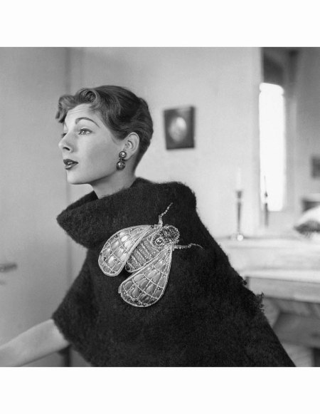 Fiona modeling black boucle shetland stole with oversized insect pin, both by Schiaparelli Vogue 1952 © Robert Randall